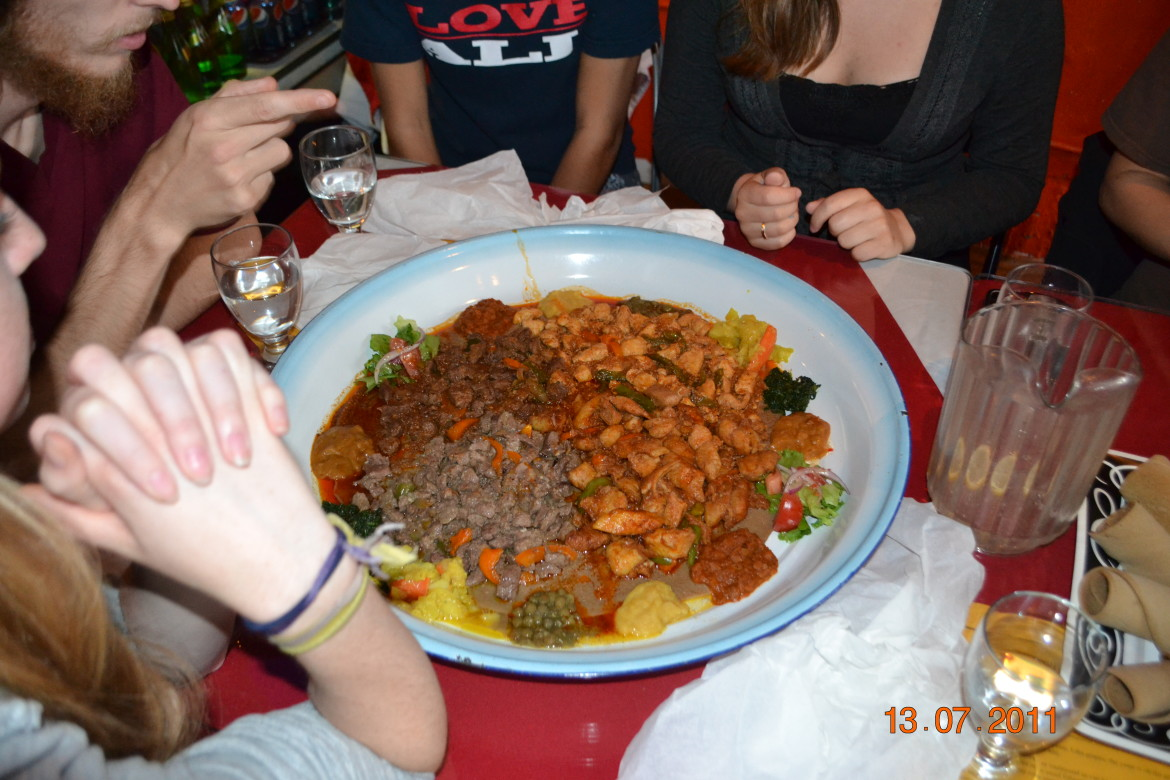 Eating together at an Ethiopian restaurant in Vancouver
